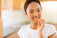 African girl eating tomato Royalty Free Stock Image