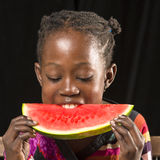 African girl eating Royalty Free Stock Image