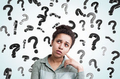 African girl and floating question marks Stock Image