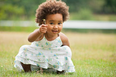 African girl with a flower Royalty Free Stock Photos