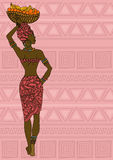 African girl with fruit basket on the head. Illustration of African girl with fruit basket on the head on a ethnic patterned background royalty free illustration