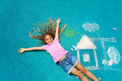 African girl and her chalk paiting Royalty Free Stock Image
