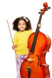 African girl holding cello with fiddlestick Royalty Free Stock Photos