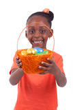 African girl holding chocolate ester egg Royalty Free Stock Images