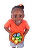 African girl holding chocolate ester egg Stock Photo