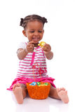 African girl holding chocolate ester egg Royalty Free Stock Photos