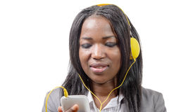 African girl holding mobile phone and listening to music Royalty Free Stock Images