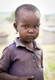 African girl of Masai  tribe village looking to the camera, Tanz Royalty Free Stock Photo