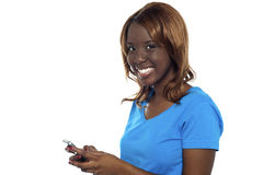 African girl messaging her friends Stock Images