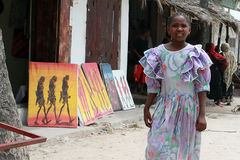 African girl misses souvenir shop and art outdoor. Royalty Free Stock Images