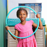 African girl playing with hula hoop Royalty Free Stock Image