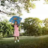 African Girl Playing Kite Activity Concept Stock Image