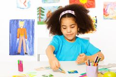 African girl plays developmental game putting card Royalty Free Stock Image