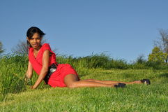 African girl relaxing in a field of green Royalty Free Stock Photos