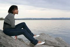African girl on the rocks Royalty Free Stock Image