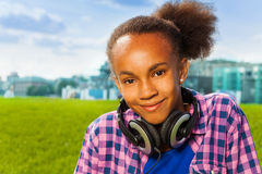 African girl sitting on green grass in summer Royalty Free Stock Photos