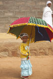 African girl with umbrella, Africa. Young girl  with umbrella  in Ethiopia, Africa Stock Photography