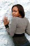 African girl up against a wall royalty free stock photos