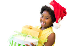African girl wearing christmas hat with presents. Close up portrait of happy little afro american girl wearing christmas hat, Kid holding christmas gifts Stock Photos