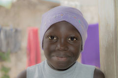 African girl wearing a cotton cap, ten years old Royalty Free Stock Image