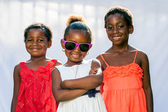 African girl wearing fun shades with friends. Stock Photo