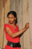 African girl at a wood sided barn Royalty Free Stock Images