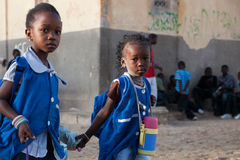 African girls dressed in blue on the way to school in Senegal Royalty Free Stock Photo