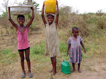 African girls taking water - Ghana Royalty Free Stock Photo
