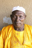 African Grand Father. Portrait of a Great Father in his African home in Ouagadougou stock images
