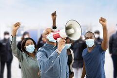 Free African Group Of People Wearing Face Mask Protest Stock Photos - 214986343