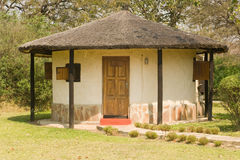 African guest house. A view of a small African guest house or grass roofed hut Royalty Free Stock Photos