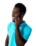 African guy communicating via cellphone Royalty Free Stock Photo