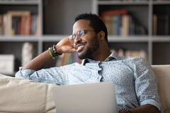 Free African Guy Distracted From Using Laptop Daydreams Looking At Window Stock Photo - 186860770