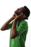 African guy enjoying music with headphones Royalty Free Stock Photos