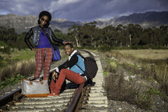 African guy and girl waiting for train Stock Images