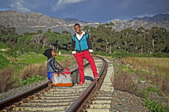 African guy and girl waiting for train Royalty Free Stock Photo