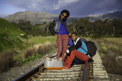 African guy and girl waiting for train Stock Photography