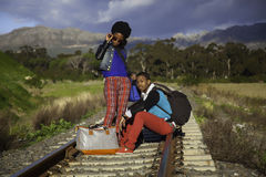 African guy and girl waiting for train Stock Photo