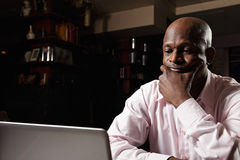 African guy at laptop Stock Photo
