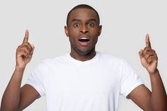 African guy open mouth feels amazed pointing fingers up stock images