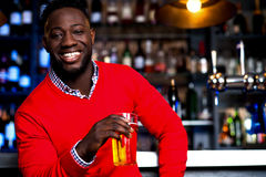 African guy posing with chilled beer stock image