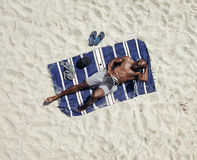 African guy relaxing on beach holiday Stock Photos