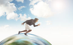 African guy running on the globe Stock Image