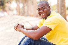 African guy urban city. Handsome african american guy sitting in urban city Stock Photography