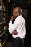 African guy in a wine shop Stock Photos