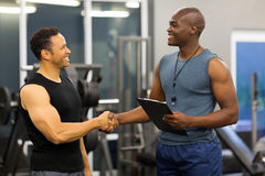 African gym trainer client stock images