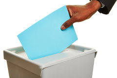 African hand with ballot paper at elections box Stock Photos