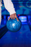 African hand holding a bowling ball Stock Photo