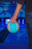 African hand holding a bowling ball Royalty Free Stock Photos