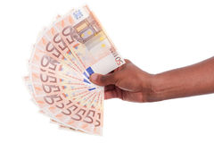 African hand holding money Stock Image